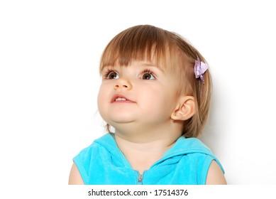 The little girl on a light background. Portrait