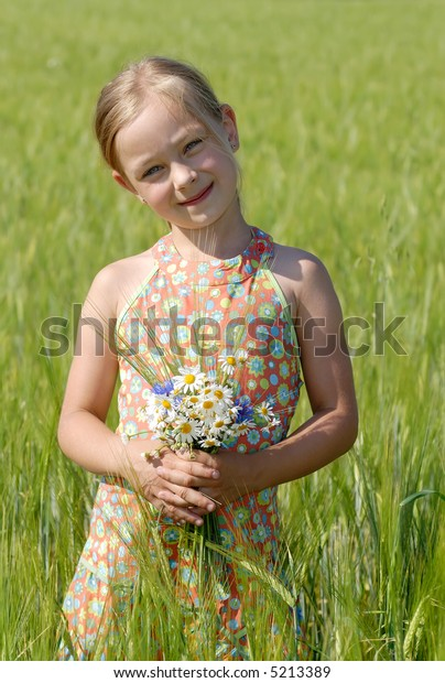 A Little girl on a meadow