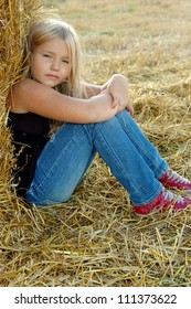 little girl on new straw in a floor