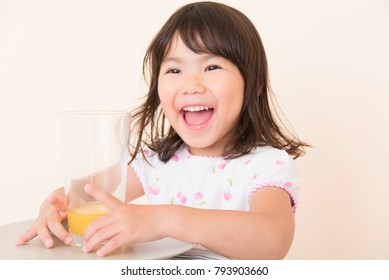 little girl on orange background
