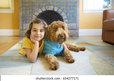 Little Girl on the Rug with Her Dog