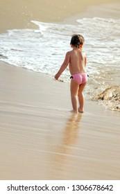 Little girl on the shore