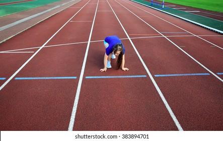 Little girl on the start on the stadium