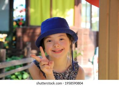 Little girl on the summer camp