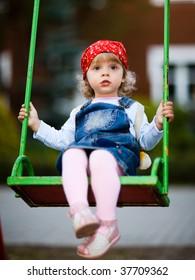 Little girl on a swing - shallow DOF