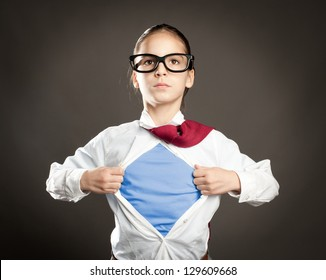 little girl opening her shirt like a superhero