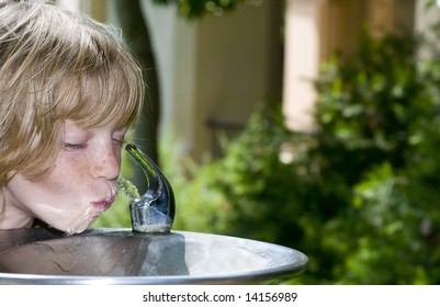 Little Girl (or Boy) slurping at the Drinking Fountain