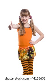 Little girl in the orange dress is showing thumbs up on white background. Portrait of an attractive young teenage rmake gesture ok in orange over white background.