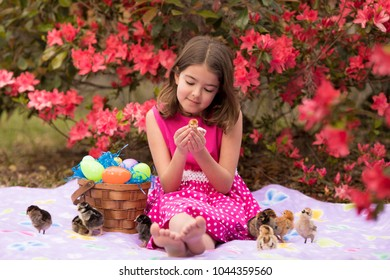 Little girl outside with easter basket and baby chicks