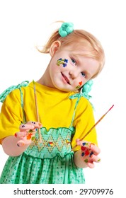 little girl with paintbrush