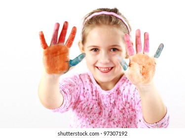 Little girl with painted hands on white background