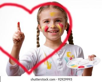 Little girl painting heart