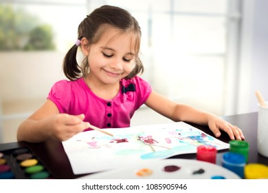 Little Girl Is Painting Picture