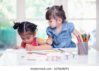 little girl painting a picture in home studio