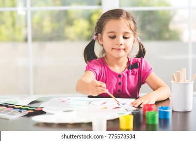 Little Girl Is Painting Picture At Home