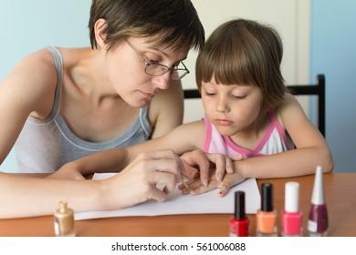 Little girl paints nails