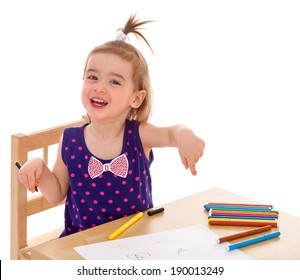 little girl with paints at the table.Isolated on white background.
