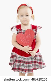 little girl with a paper heart on a white background.