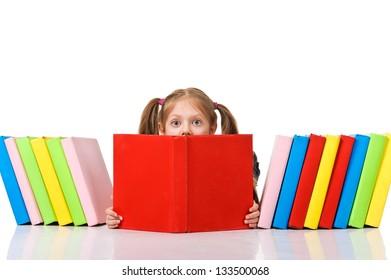 Little girl peeking from pile of books. Isolated over white