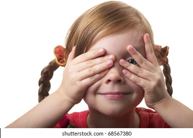 Little girl peeping through hand with one eye isolated over white background