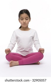 Little girl performing Yoga in Lotus position