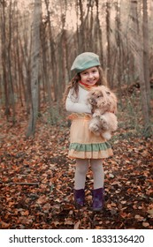 little girl with a pet rabbit in  autumn forest