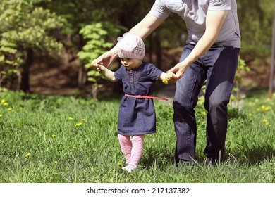 little girl picking flowers in the park
