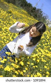 Little girl picking flowers (yellow field)