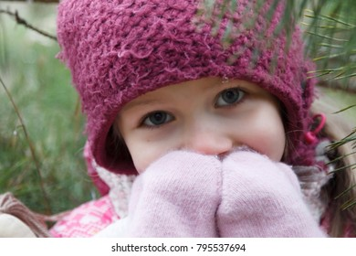 Little girl in a pine forest.