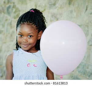 Little girl with pink balloon. She is about 5 years old. Room for text left and right.