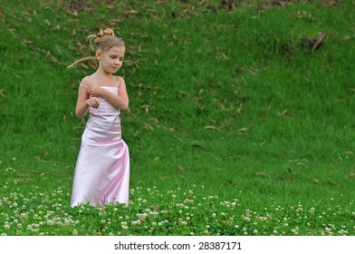 Little girl in pink dress on the grass