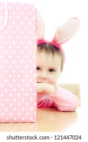 The little girl with pink ears bunny and bag on white background.