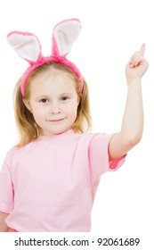 The little girl with pink ears bunny points to the top on white background.