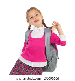 Little girl in pink school uniform with a backpack is having fun with her braid, isolated