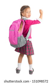 Little girl in pink school uniform with a backpack is writing imaginary message on white background, isolated