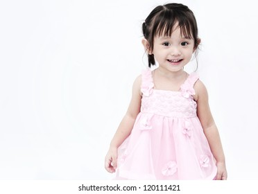 Little girl in pink smiling