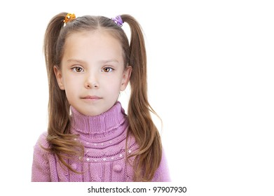 Little girl in pink sweater and with tails, isolated on white background.