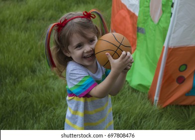 little girl play with ball in the park