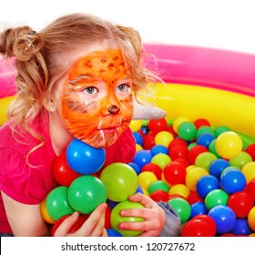 Little girl play colourful balls. Make up.