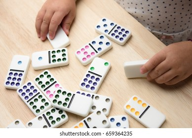 Little girl play domino game
