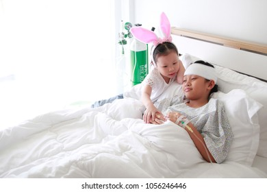 little girl playinf and  holding patient's hand for encouragement and empathy.
