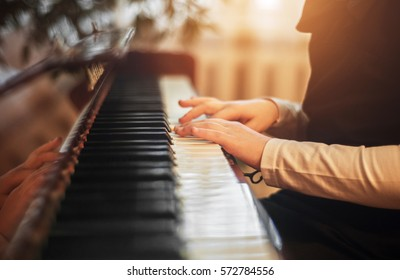 little girl playing acoustic piano in studio
