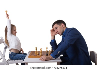 little girl playing chess with his father on a white background