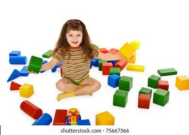 Little girl playing with colored cubes on the floor isolated on white background