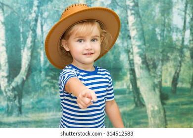 Little girl playing in cowboy brown hat.