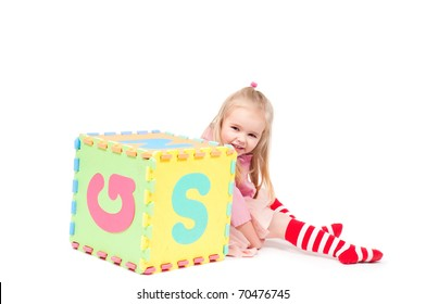 Little girl playing with cube