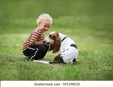 Little girl playing with a dog in the park