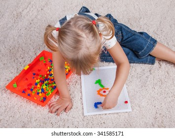 little girl playing with education mosaic pins toy