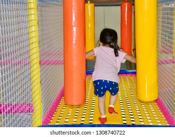 Little girl playing in an indoor playground