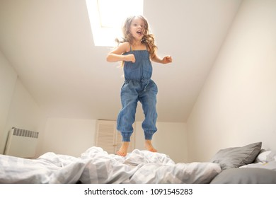 little girl playing  and jumping at home